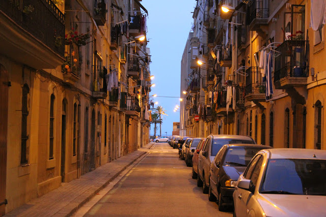 an illuminated lane in the nighttime Barcelona