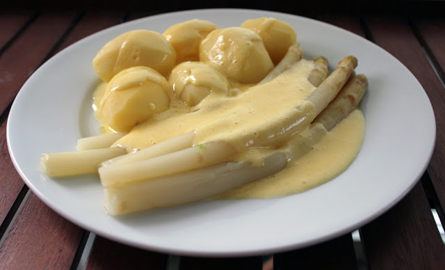 fresh, homemade hollandaise sauce with asparagus and potatoes